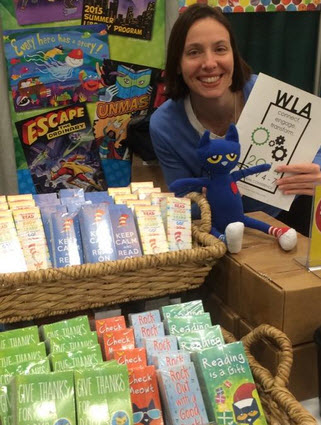Demco Product Development Manager Liz Bowie checks out the groovy sessions at WLA with Pete the Cat.
