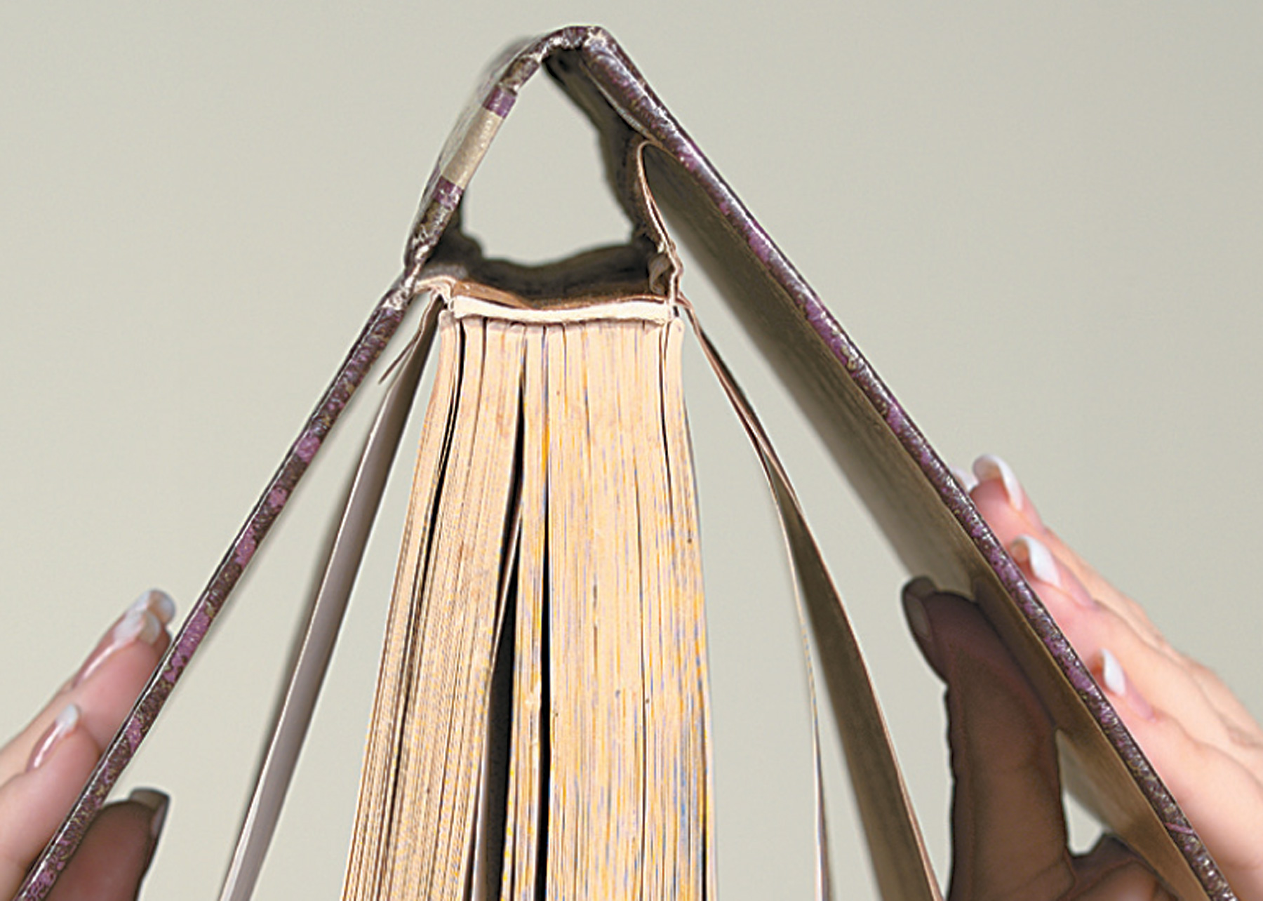 A loose hinge is the first sign of trouble for book binding.