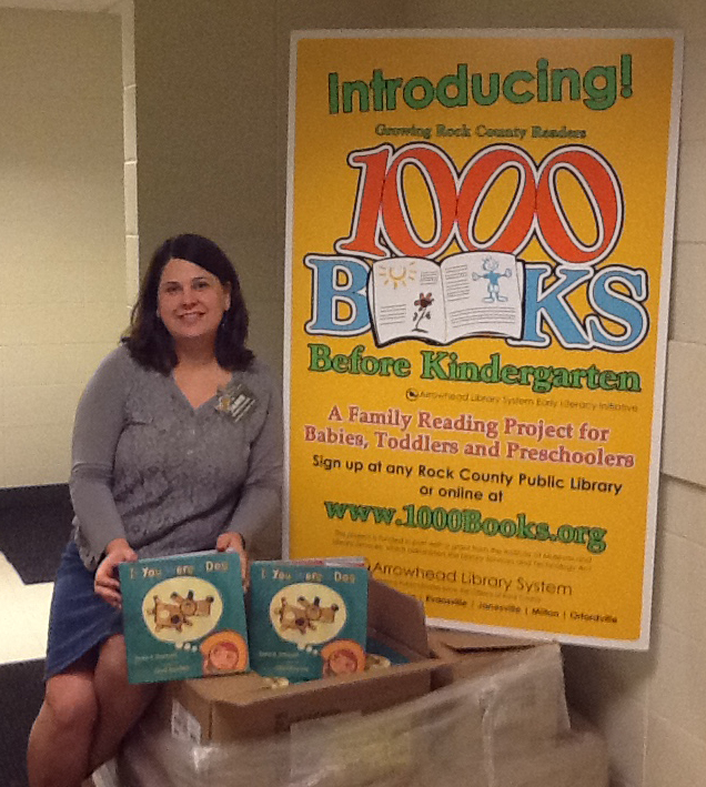 Youth Services Associate and local author Jamie Swenson with copies of her book,