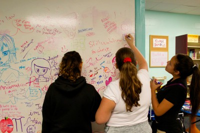 Students getting creative on our whiteboard wall in our makerspace.