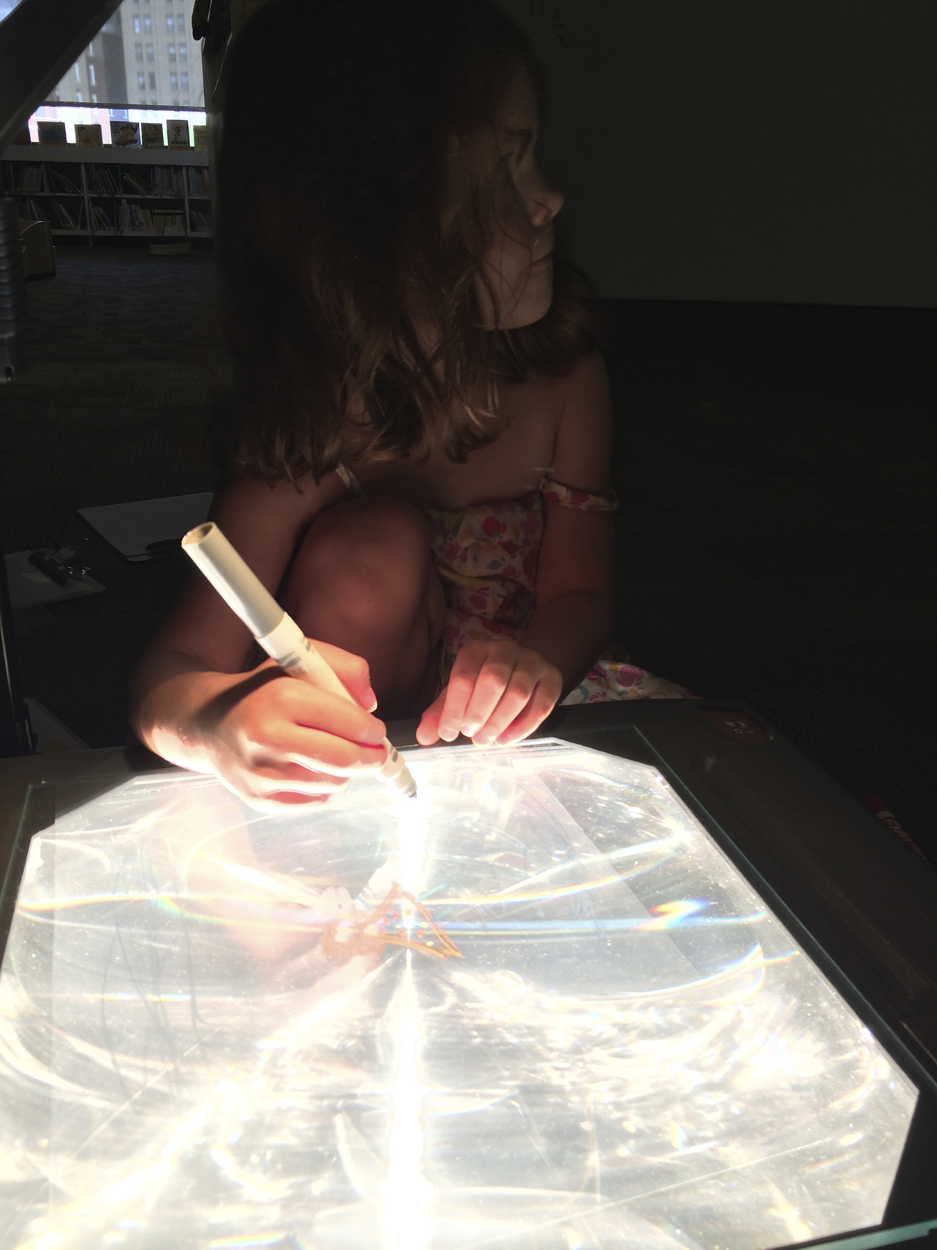 At the overhead projector, a child becomes the storyteller.