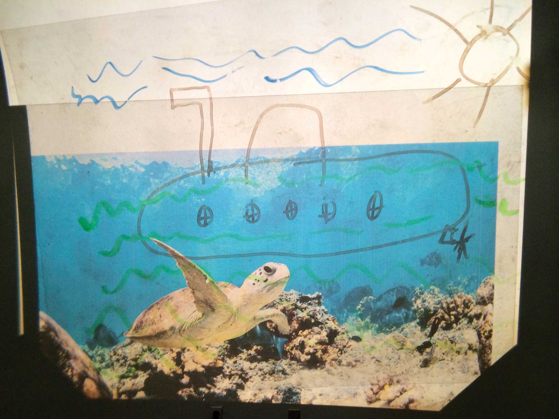 "A child's drawing inspired by listening to The Beatle's song ""Yellow Submarine."""