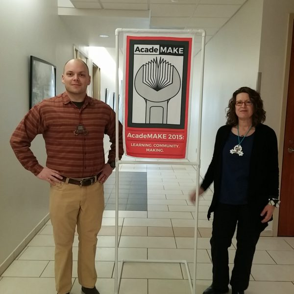 Paralibrarian_of_year_Brown_w_Colleague_and_Sign_1