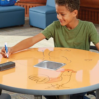 Kid drawing on table