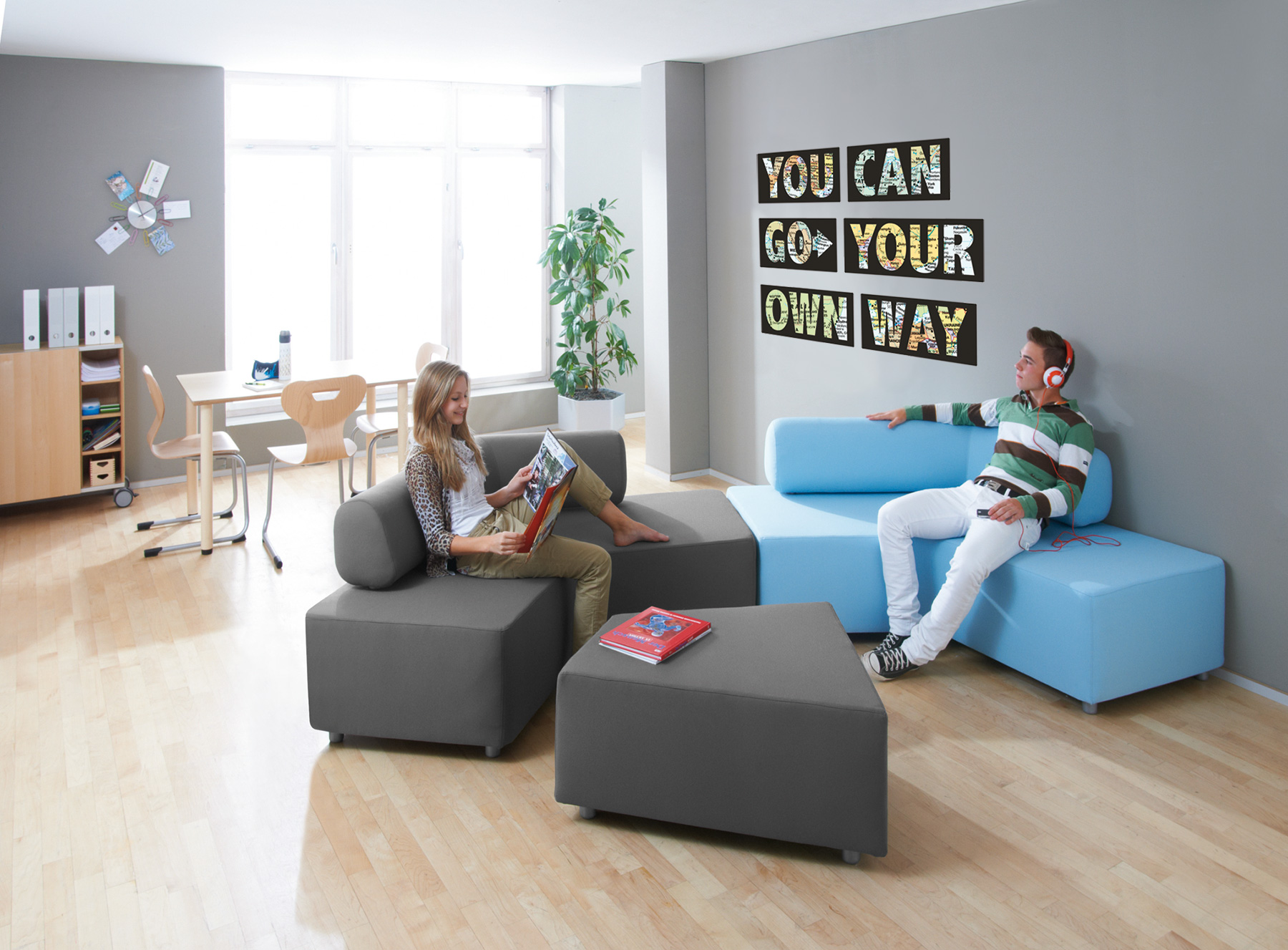 Add Some Modular Flexibility to Your Library Spaces With the HABA Boomerang Sofa and Ottoman.