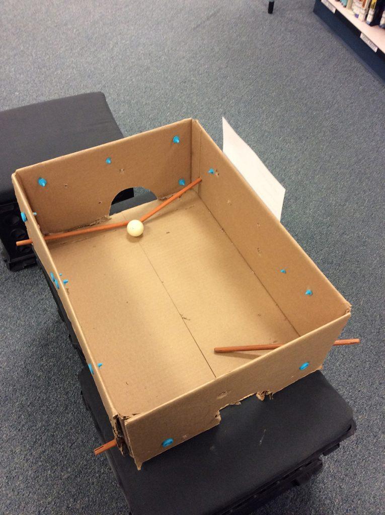 "Student-created cardboard ""skittle box."""