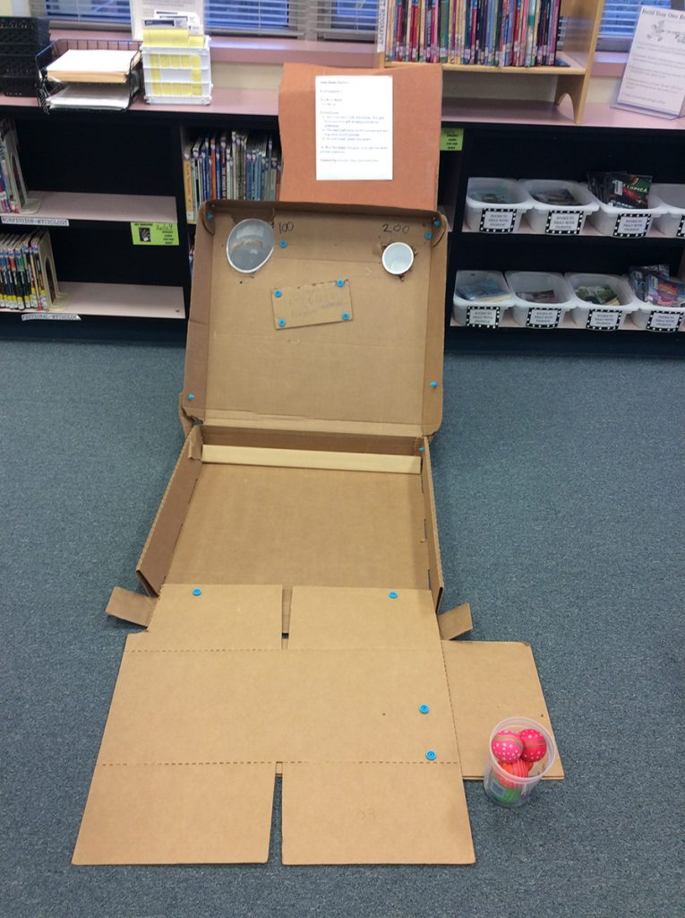 Student-created cardboard arcade game.