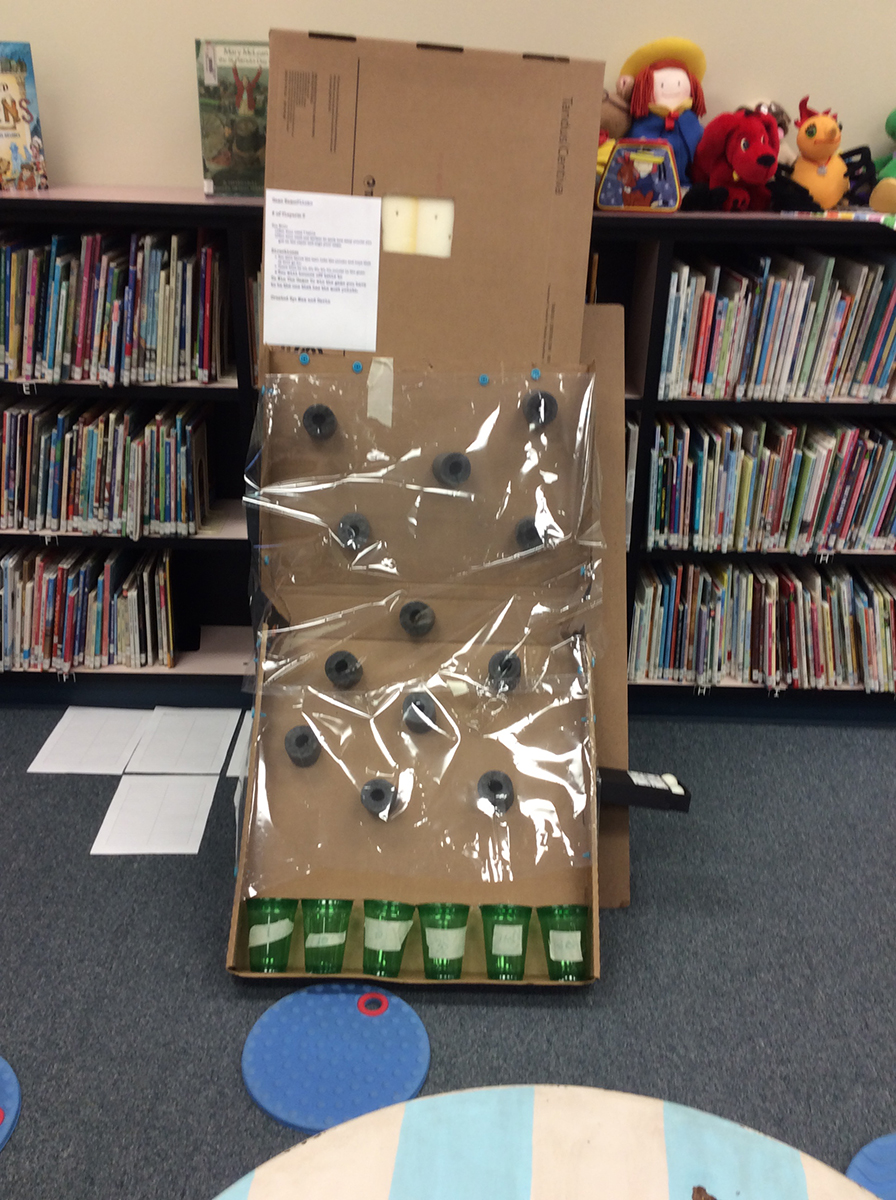 Student-created cardboard arcade game.