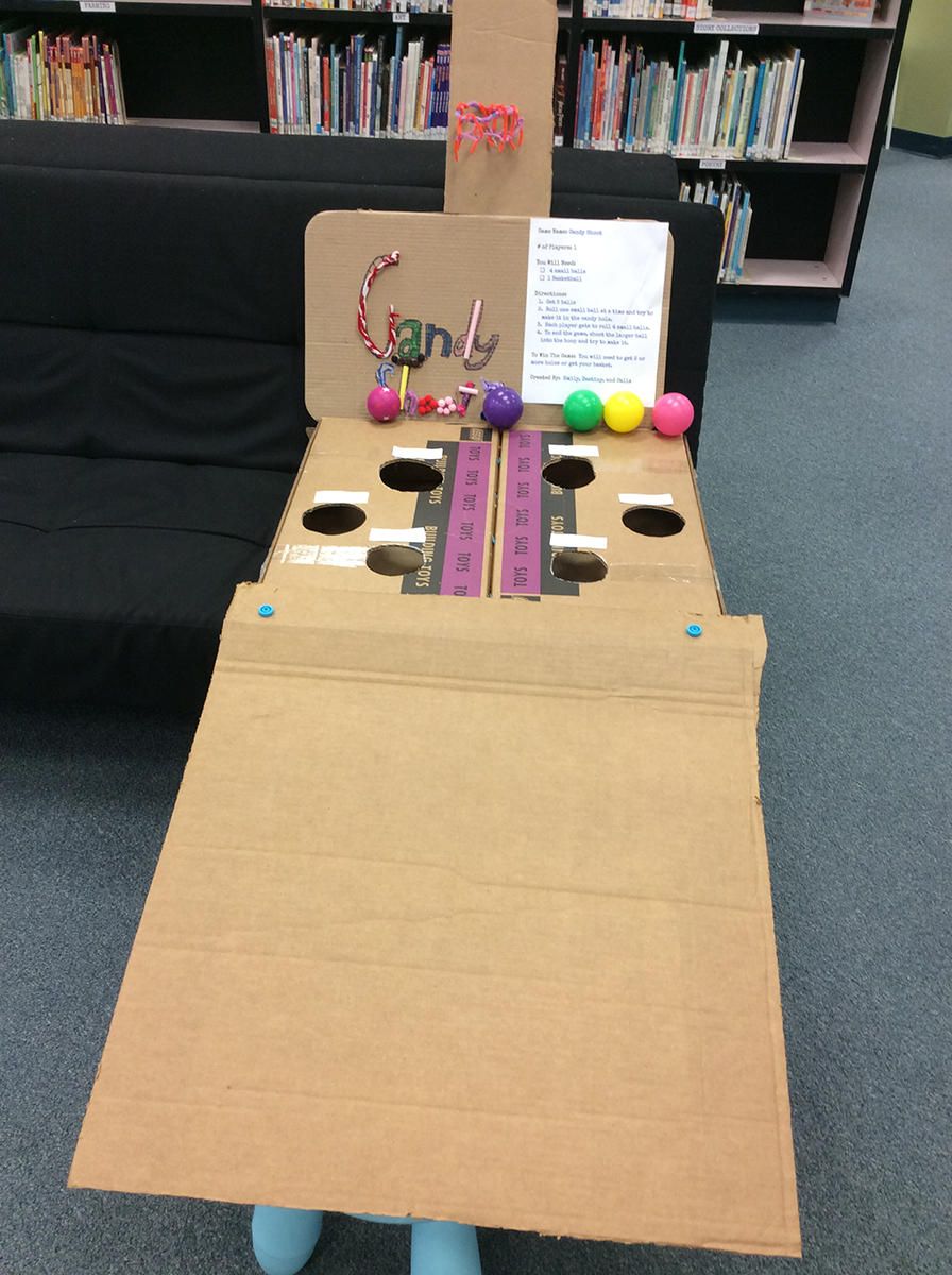 "Student-created cardboard ""skee-ball"" game."