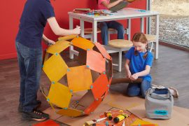 Kids building with Makedo.