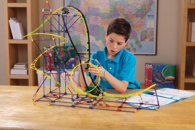 Boy working on K'NEX project
