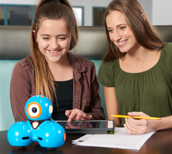 Teacher and student working on a Dash robot activity.
