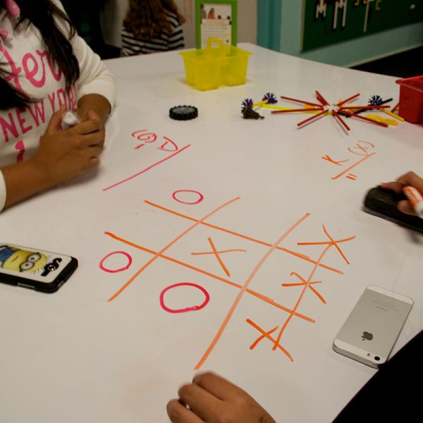 Playing tic-tac-toe on a whiteboard table