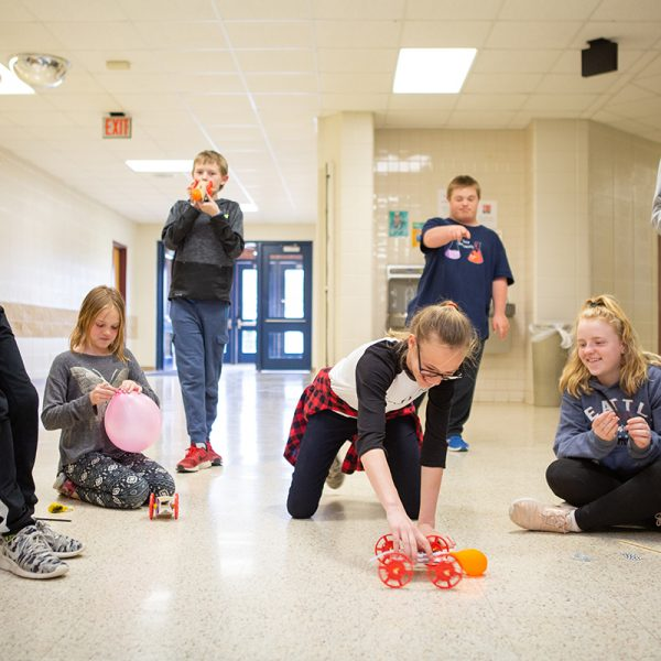 Students at Mineral Point Middle School racing balloon cars.