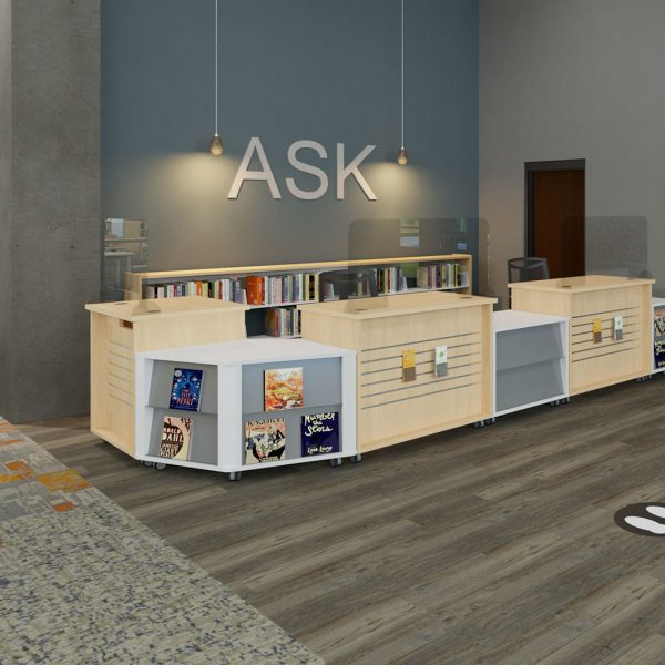 Acrylic barriers at circulation and reference desks help protect staff and patrons.