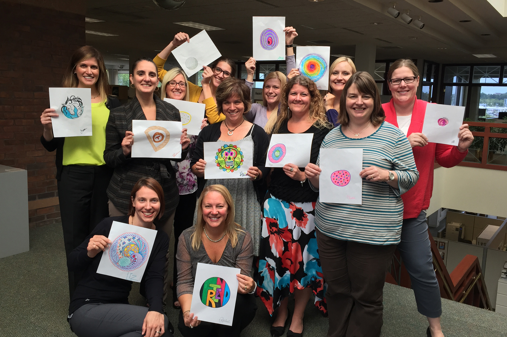 Demco President Nedra Sadorf and crew make their mark for International Dot Day 2015.