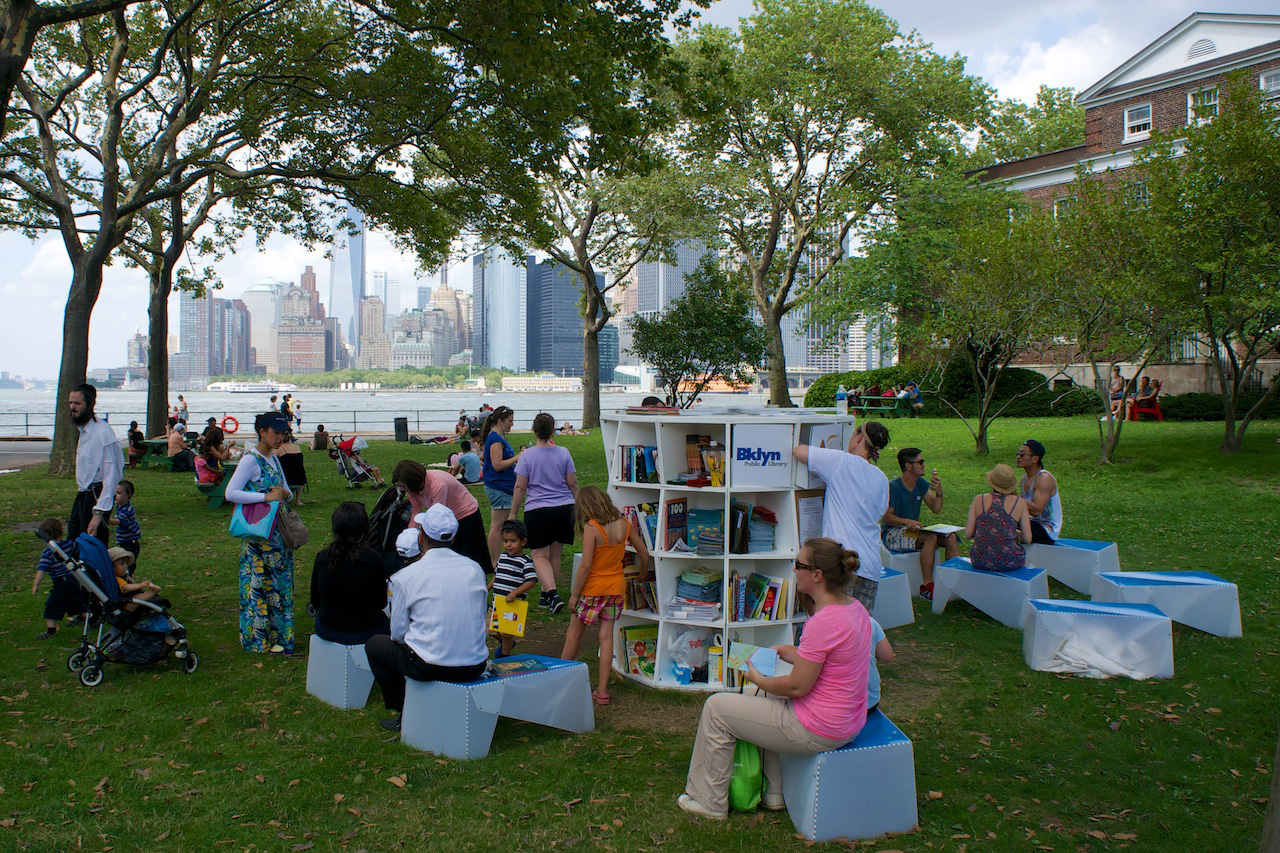 Reader's enjoy the pop-up library on Library Lawn on Governor's Island. © Leigh Hurwitz