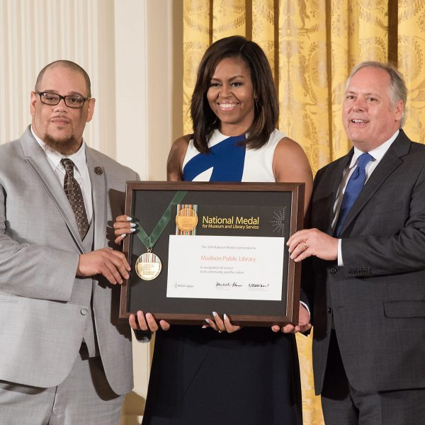 Rob Dz and Director Greg Mickells receive the IMLS National Medal for Museum and Library Service from First Lady Michelle Obama.