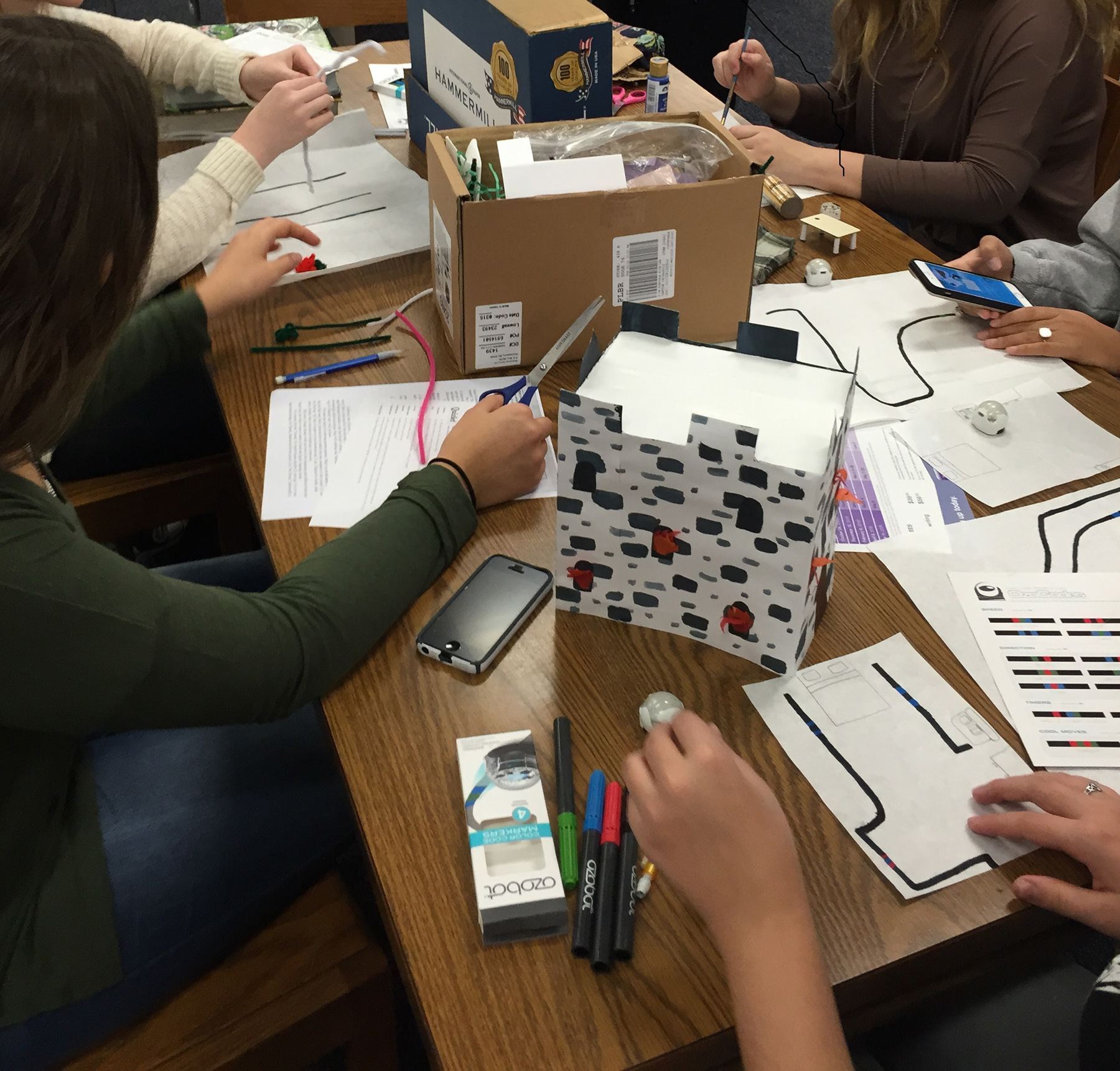 Some group members built a set while others worked on coding the Ozobots with markers.