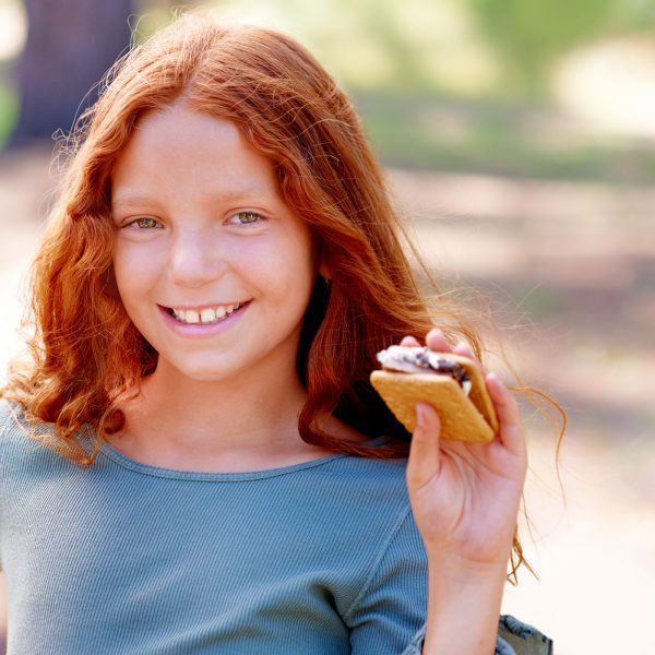 Girl eating S'more