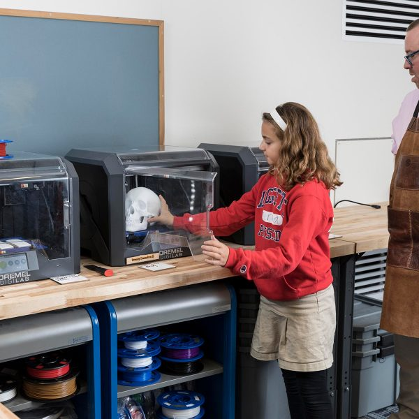 Girl working with 3D printer
