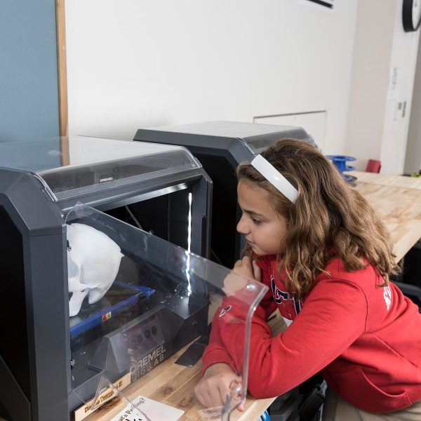 Girl working on 3D printer project